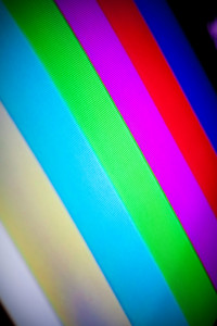 Closeup of a standard picture tube tv set with the rainbow color bars displayed.