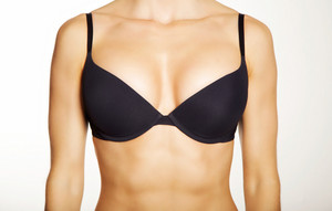 Closeup of a woman wearing a black bra isolated on white background