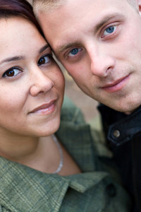 Closeup of a young happy couple together.  Shallow depth of field.