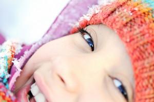 Closeup of girl laying in snow