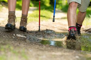 Closeup of hiker legs wearing trekking boots