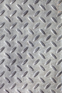 Closeup of real diamond plate metal material. This is the real thing and not an illustration.