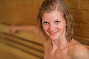 Closeup of smiling sweaty woman in sauna