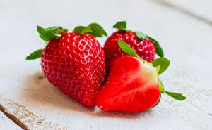 Closeup Of Strawberries On Wooden Backgorund