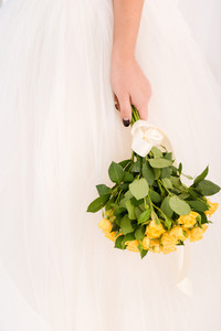 Closeup portrait bride holding wedding flowers