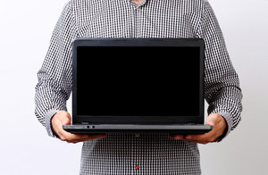 Closeup portrait of a businessman holding laptop