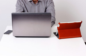 Closeup portrait of a businessman working on the laptop