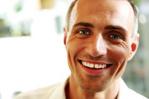 Closeup portrait of a handsome happy man
