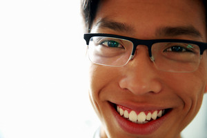 Closeup portrait of a happy asian man in glasses