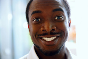 Closeup portrait of a happy black man