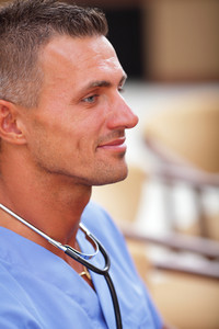 Closeup portrait of a happy mature doctor with stethoscope