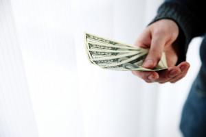 Closeup portrait of a male hand giving money