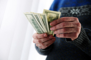 Closeup portrait of a male hands holding US dollars