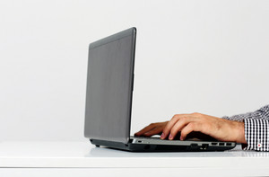 Closeup portrait of a male hands typing on the laptop