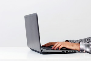 Closeup portrait of a male hands using on the laptop