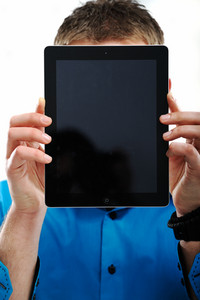 Closeup portrait of a man covering his face with ipad
