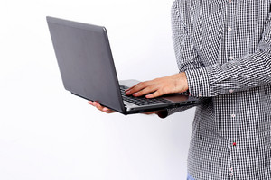Closeup portrait of a man using laptop