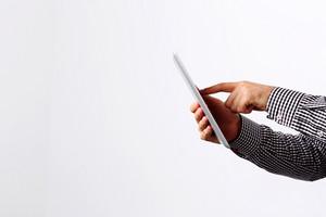 Closeup portrait of a man using tablet computer