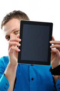 Closeup portrait of a man with his face behind ipad