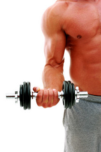 Closeup portrait of the man's body with dumbbell