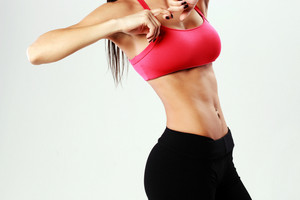 Closeup portrait of young sport woman with perfect fitness body