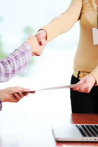 Closing a successful deal with a handshake. Congratulations! Getting a new job.