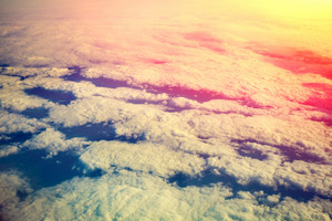 Cloudy sky at sunrise. View from airplane window