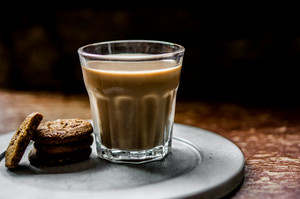 Coffee With Cookies On Rustic Background