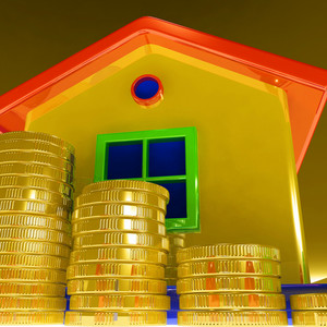 Coins Around House Showing Paying Rent