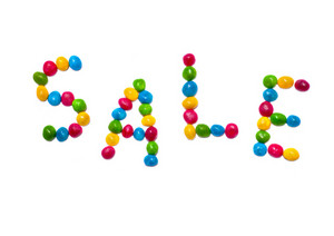 Colorful candies forming word 'sale'