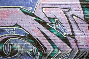 Colorful graffiti spray painted on a brick wall - makes a great background or backdrop.