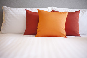 Colorful Pillow on hotel bed