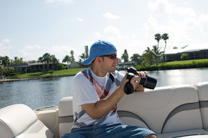 Commercial stock photographer during a photo shoot outdoors.