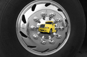 commercial truck mirrored in hubcap