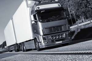 commercial trucks driving on straight freeway