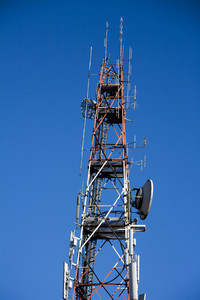 Communication tower on blue sky background