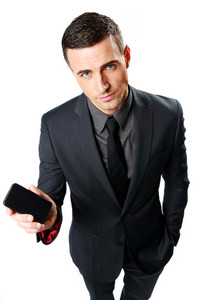 Confident businessman showing blank smartphone screen isolated on a white backgorund