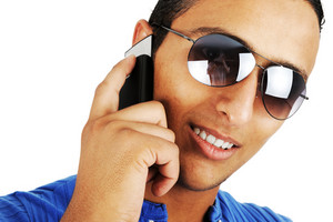 Confident young man talking on mobile