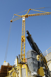 construction crane hoisting planks