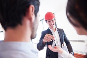 Construction man hands over keys
