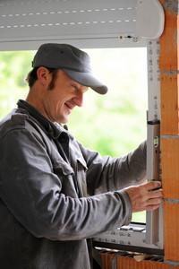 Construction man using level tool