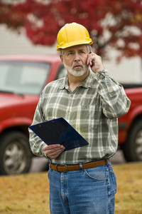 Construction Supervisor Makes Phone Call