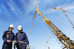 construction workers and mobile cranes