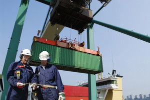 container port workers and cranes