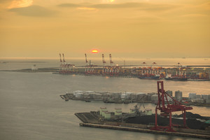 Container stacks and crane in shipyard at sunset for cargo Goods and Logistic background