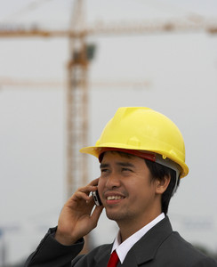 Contractor On The Phone At Building Site