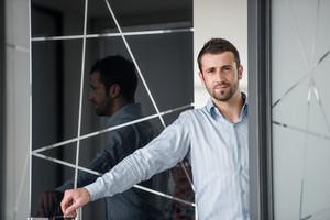 Corporate man opening his office door