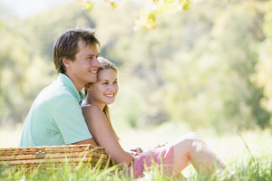 Couple at park having a picnic and smiling