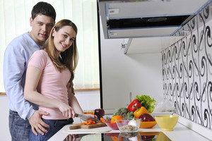 Couple having fun and preparing healthy food in kitchen