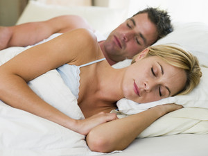 Couple in bed cuddling